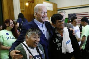 ASSOCIATED PRESS                                 Democratic presidential candidate and former Vice President Joe Biden poses for a photo with attendees after speaking at a campaign event.