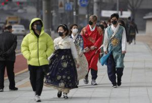 ASSOCIATED PRESS                                 Visitors wearing face masks walk near the Gwanghwamun, the main gate of the 14th-century Gyeongbok Palace, and one of South Korea's well-known landmarks, in Seoul, South Korea. South Korea's Vice Health Minister Kim Gang-lip says the outbreak has entered a serious new phase but expressed cautious optimism that it can be contained to the region surrounding Daegu, where the first case was reported on Tuesday.