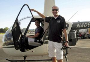 COURTESY GROUP 3 AVIATION                                 Helicopter pilot Ara Zobayan stands outside a helicopter.