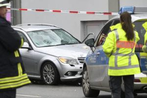 DPA VIA ASSOCIATED PRESS                                 Police stand next to the scene of the accident with the car that is said to have crashed into a carnival parade today in Volkmarsen, central Germany.