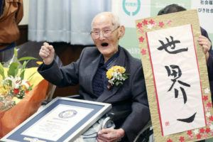 KYODO NEWS VIA AP                                 Chitetsu Watanabe, 112, poses next to the calligraphy he wrote after being awarded as the world's oldest living male by Guinness World Records, in Joetsu, Niigata prefecture, northern Japan on Feb. 12.