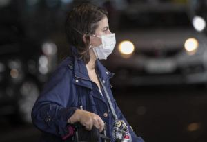ASSOCIATED PRESS                                 A passenger wearing a mask as a precaution against the spread of the new coronavirus COVID-19 arrives to the Sao Paulo International Airport in Sao Paulo, Brazil, today.