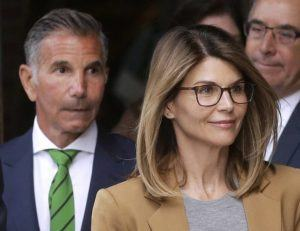 ASSOCIATED PRESS                                 Actress Lori Loughlin, front, and her husband, clothing designer Mossimo Giannulli, left, depart federal court in Boston last year.