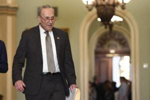 ASSOCIATED PRESS                                 Senate Minority Leader Sen. Chuck Schumer of N.Y., arrives for a news conference on Capitol Hill in Washington on Tuesday.