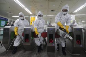 ASSOCIATED PRESS                                 Workers wearing protective gear sprayed disinfectant as a precaution against the new coronavirus at a subway station in Seoul, South Korea, Friday. Japan's schools prepared to close for almost a month and entertainers, topped by K-pop superstars BTS, canceled events as a virus epidemic extended its spread through Asia into Europe and on Friday, into sub-Saharan Africa.