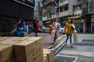 NEW YORK TIMES People rush to buy necessities in Hong Kong on Thursday. Rumors of an impending toilet paper shortage due to the coronavirus outbreak incited Hong Kong residents to make a furious dash to stock up, despite little evidence supplies were running low.