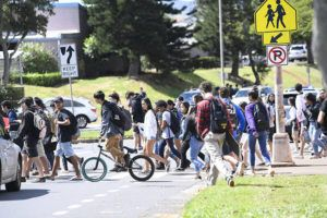 BRUCE ASATO / BASATO@STARADVERTISER.COM                                 Students made their way off the Mililani High School campus today after two teens were seriously injured in a stabbing on campus.