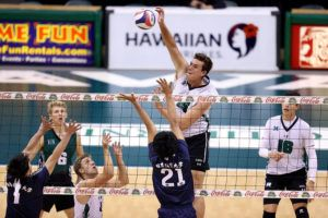 ANDREW LEE / Special to the Star-Advertiser                                 Hawaii's Patrick Gasman (15) slams down a point over Nittaidai's Shuto Kawaguchi (21) during the first set of an Exhibition Men's Volleyball match on Wednesday, at the Stan Sheriff Center.