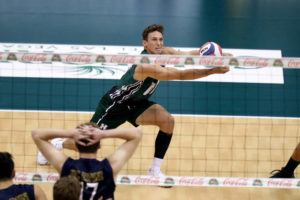 ANDREW LEE / SPECIAL TO THE STAR-ADVERTISER                                 Hawaii's Colton Cowell digs the ball during the first set.