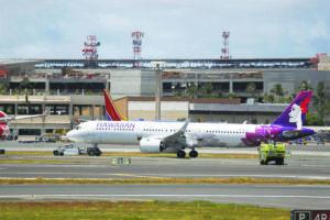 CINDY ELLEN RUSSELL/2019                                 A Hawaiian Airlines plane sat on the runway at Daniel K. Inouye International Airport.