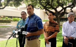 CRAIG T. KOJIMA / CKOJIMA@STARADVERTISER.COM                                 City leaders announce today the filing of a lawsuit holding large fossil fuel companies accountable for the costs and consequences of climate change on Honolulu and its taxpayers. From left, Department of Facility Maintenance Director Ross Sasamura, Chief Resilience Officer and Executive Director of the Office of Climate Change, Sustainability and Resiliency Josh Stanbro, Honolulu City Councilman Joey Manahan, and Acting Corporation Counsel Paul Aoki.