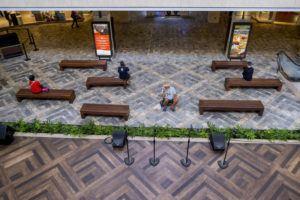 DENNIS ODA / DODA@STARADVERTISER.COM A handful of shoppers sit at Ala Moana on Wednesday.
