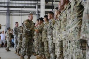 """BRUCE ASATO / APRIL 20                                 Major General Arthur """"Joe"""" Logan, Adjutant General, Hawaii, shakes hands with each one of about 80 soldiers of the Hawaii Army National Guard during a deployment ceremony at Kalaeloa, Hawaii."""