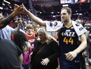 ASSOCIATED PRESS Utah Jazz forward Bojan Bogdanovic (44) high-fives a fan after shooting the game-winning three point basket during the second half of an NBA basketball game against the Houston Rockets on Sunday.