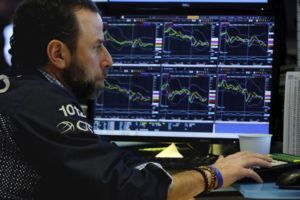 ASSOCIATED PRESS                                 Specialist Michael Pistillo works at his post on the floor of the New York Stock Exchange. Stocks are falling sharply again, and bond yields have sunk to more record lows on worries about the economic damage from the coronavirus outbreak.