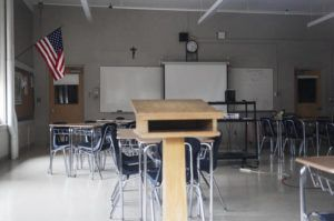 ASSOCIATED PRESS                                 A classroom was seen, March 6, vacant through a window at Saint Raphael Academy in Pawtucket, R.I., as the school remained closed following a confirmed case of the coronavirus.
