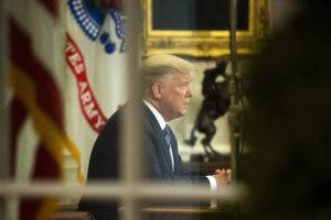 ASSOCIATED PRESS                                 President Donald Trump addresses the nation from the Oval Office at the White House, Wednesday, in Washington.