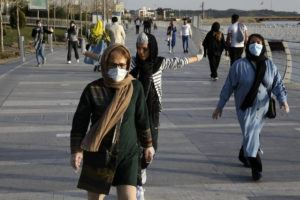 ASSOCIATED PRESS People wearing face masks exercise on the shore of an artificial lake in western Tehran, Iran.