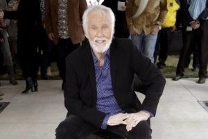 """ASSOCIATED PRESS / 2017                                 Kenny Rogers poses with his star on the Music City Walk of Fame in Nashville, Tenn. Rogers, the smooth, Grammy-winning balladeer who spanned jazz, folk, country and pop with such hits as """"Lucille,"""" """"Lady"""" and """"Islands in the Stream"""" and embraced his persona as """"The Gambler"""" on record and on TV died tonight. He was 81."""