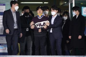 """KIM HONG-JI/POOL PHOTO VIA ASSOCIATED PRESS                                 Cho Ju-bin, center, leader of South Korea's online sexual blackmail ring which is so-called """"Nth room,"""" walked out of a police station as he was transferred to prosecutors' office for further investigation in Seoul, South Korea, Wednesday. South Korean prosecutors on Wednesday began reviewing whether to formally charge a man arrested last week on allegations he operated secretive chatrooms where he posted sexually abusive videos of blackmailed women in return for cryptocurrency payments."""