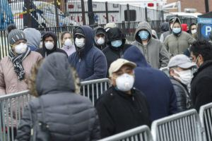 ASSOCIATED PRESS                                 Patients wear personal protective equipment while maintaining social distancing as they wait in line for a COVID-19 test at Elmhurst Hospital Center, today, in New York.