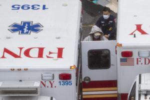 ASSOCIATED PRESS                                 A paramedic transports a patient into the Trauma Center at the Elmhurst Hospital Center today in the Queens borough of New York.