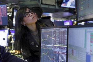 ASSOCIATED PRESS                                 Specialist Erica Fredrickson works on the floor of the New York Stock Exchange, Monday.