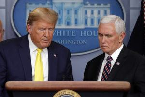 ASSOCIATED PRESS                                 President Donald Trump steps from the podium to allow Vice President Mike Pence to speak in the briefing room of the White House in Washington today about the coronavirus outbreak.