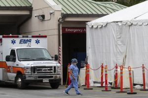 GEORGE F. LEE / GLEE@STARADVERTISER.COM A larger white tent is seen today where yellow 'disaster tents' had been erected outside of the emergency room at The Queen's Medical Center in anticipation of COVID-19 cases.