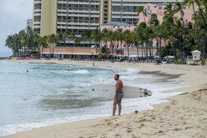 STAR-ADVERTISER                                 Waikiki Beach was empty of beachgoers on March 26.