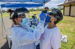DENNIS ODA / APRIL 15                                 Kalihi Kai Urgent Care conducts COVID-19 testing at Asing Community Park in Ewa Beach earlier this month. Roughly 2.1% of the more than 28,260 coronavirus tests by state and private laboratories in Hawaii have been positive.