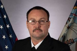 ASSOCIATED PRESS                                 A photo provided by the U.S. Navy shows Chief Petty Officer Charles Robert Thacker Jr., 41, of Fort Smith, Ark., assigned to the USS Theodore Roosevelt, who died from the coronavirus Monday at U.S. Naval Hospital Guam.