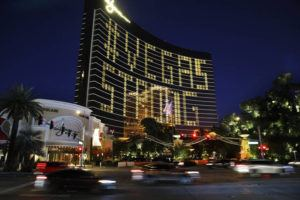 """ASSOCIATED PRESS                                 Hotel room lights spell out """"Vegas Strong"""" at the Wynn hotel-casino along the Las Vegas Strip as casinos and other business are shuttered due to the coronavirus outbreak on Wednesday."""