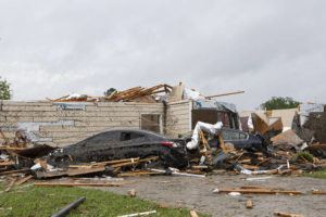 THE NEWS-STAR VIA AP                                 A home had its roof torn off after a tornado ripped through Monroe, La.