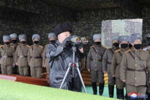 KOREAN CENTRAL NEWS AGENCY/KOREA NEWS SERVICE VIA AP                                 In this Feb. 28 photo provided by the North Korean government, North Korean leader Kim Jong Un, center, inspects the military drill of units of the Korean People's Army, with soldiers shown wearing face masks.