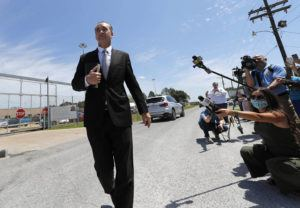 ASSOCIATED PRESS                                 Tony Spell, pastor of the Life Tabernacle Church, walks to his church bus as he leaves East Baton Rouge Parish jail after posting bond in Baton Rouge, La., on April 21. Louisiana authorities arrested the pastor on an assault charge after he admitted that he drove his church bus toward a man who has been protesting his decision to hold mass gatherings in defiance of public health orders during the coronavirus pandemic.