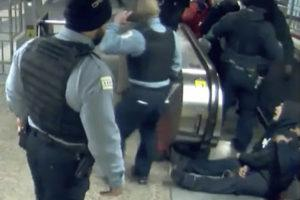 CHICAGO TRANSIT AUTHORITY VIA ASSOCIATED PRESS                                 Feb. 28, 2020, image from Chicago Transit Authority video provided by the Civilian Office of Police Accountability, police officers attend to Ariel Roman, bottom right, after he was shot by Chicago police in a subway station in Chicago. New video released Tuesday, April 28, 2020, shows Chicago police shooting Roman, an unarmed short-order cook, in the stomach and then again with his back turned to officers after they tried to stop him in a subway station for earlier walking from one train car to another.