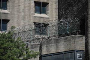 ASSOCIATED PRESS                                 Razor wire fencing at the Metropolitan Correctional Center in New York in 2019. Inmates and advocates said numerous inmates exhibiting flu-like symptoms were not tested or quarantined at several facilities, including at FCI Yazoo City in Mississippi and at the Metropolitan Correctional Center in New York.