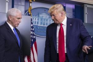ASSOCIATED PRESS                                 President Donald Trump departed after speaking about the coronavirus, with Vice President Mike Pence at left, in the James Brady Press Briefing Room of the White House, today.