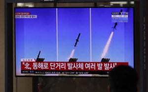 ASSOCIATED PRESS                                  People watch a TV screen airing reports about North Korea's firing missiles with file images of missiles at the Seoul Railway Station in Seoul, South Korea on Tuesday.
