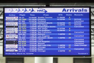 CINDY ELLEN RUSSELL / CRUSSELL@STARADVERTISER.COM                                 An arrivals monitor showing a slew of canceled flights at the Daniel K. Inouye International Airport on March 25.