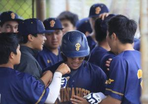 JAMM AQUINO / MAR. 14                                 Punahou's Ethan Nagamine, middle, was mobbed by teammates after his game-clinching RBI against Kamehameha. This was the last day high school sporting events were held on Oahu during the academic year.