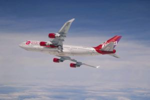 COURTESY VIRGIN ORBIT                                 A Boeing 747 with a rocket slung beneath its port wing in its final major test before an upcoming demonstration of its system in which the rocket will be carried aloft and launched. Virgin Orbit is targeting the coming weekend for its first attempt to launch a demonstration payload into space.