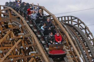 ASSOCIATED PRESS People ride the roller coaster at Lagoon Amusement Park in Farmington, Utah.