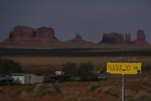 ASSOCIATED PRESS A sign marks Navajo Drive as Sentinel Mesa, homes and other structures in Oljato-Monument Valley, Utah on the Navajo Reservation.