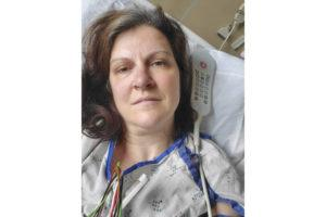 """DARLENE GILDERSLEEVE VIA ASSOCIATED PRESS                                 Darlene Gildersleeve, 43, of Hopkinton, N.H., seen May 6, at a Manchester, N.H. hospital. Gildersleeve thought she had recovered from COVID-19. Doctors said she just needed rest. And for several days, no one suspected her worsening symptoms were related — until a May 4 video call, when her physician heard her slurred speech and consulted a specialist. """"You've had two strokes,'' a neurologist told her at the hospital."""