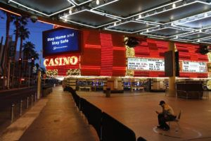 ASSOCIATED PRESS / APRIL 19                                 A lone security guard watched over casinos shuttered due to the coronavirus outbreak in Las Vegas.