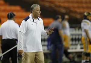 JAMM AQUINO / SEPT. 20                                 Punahou head coach Kale Ane gestures from the sideline during the second half of an ILH Open Division football game against the Saint Louis Crusaders on Sept. 20, at Aloha Stadium. The school this week placed Ane on paid leave in the wake of lawsuits alleging that Ane and other school authorities allowed sexual abuse of students to occur.