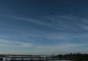 """JAMM AQUINO / 2016 U.S. Air Force F-22 Raptors perform a missing-man formation flyover above the USS Arizona. The Hawaii Air National Guard and 15th Wing active duty airmen will perform a flyover Thursday in a salute to Hawaii's frontline workers and those staying home """"to flatten the curve"""" of the coronavirus."""