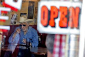 ASSOCIATED PRESS A customer eats inside the Horseshoe Cafe on May 1 in Wickenburg, Ariz.